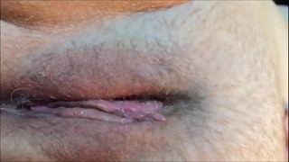 Wet vagina agonorgasmos closeup with contractions