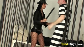 Sexy police officer dark angelika inspects a prisoner