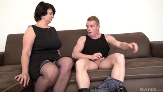 Short-haired mom in stocking and high heels gives head on the couch
