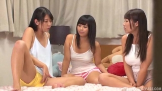 Three playful Japanese girls with natural breasts having fun in bed