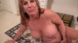 Big titted older mama on the rug in suit