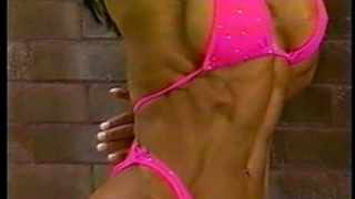 Fitness housewife showing off great body outdoors